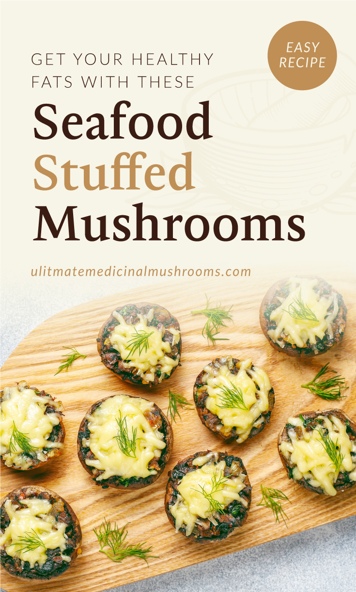"""Text area which says """"Get Your Healthy Fats with These Seafood Stuffed Mushrooms , ultimatemedicinalmushrooms.com"""" followed by a photo of baked stuffed mushrooms placed on a wooden chopping board"""