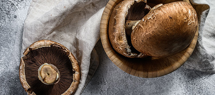 Photo of portabella mushrooms on a wooden bowl